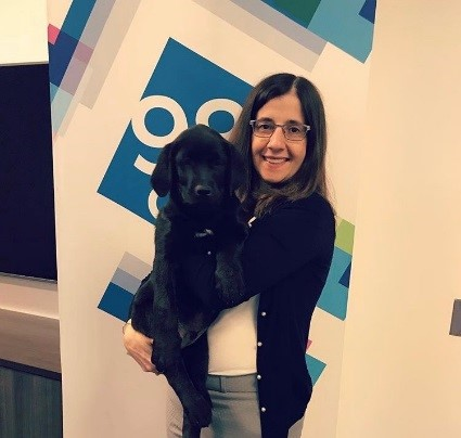 SNF law clerk, Rose, holding a labrador puppy.
