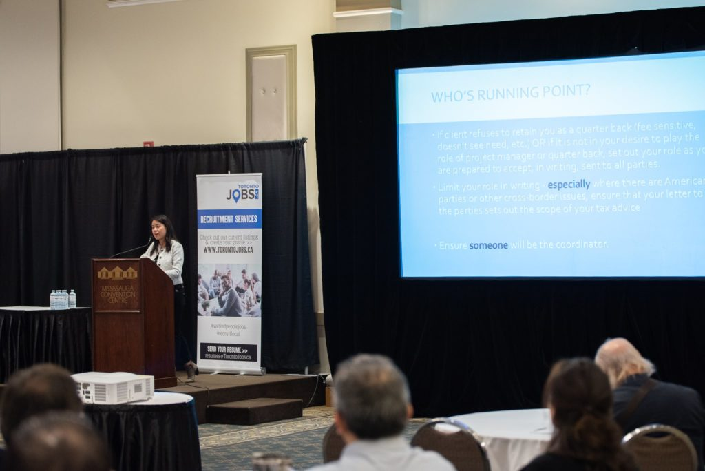 Toronto Entrepreneurs Conference speaker Molly Luu addressing attendees from the podium.