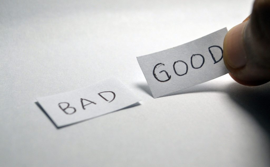 "Two pieces of paper with the words ""Bad"" and ""Good"" written on them."