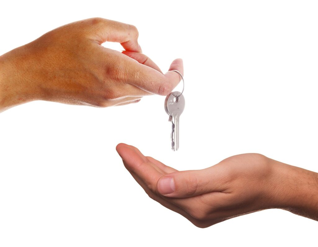 A key being placed in a hand.