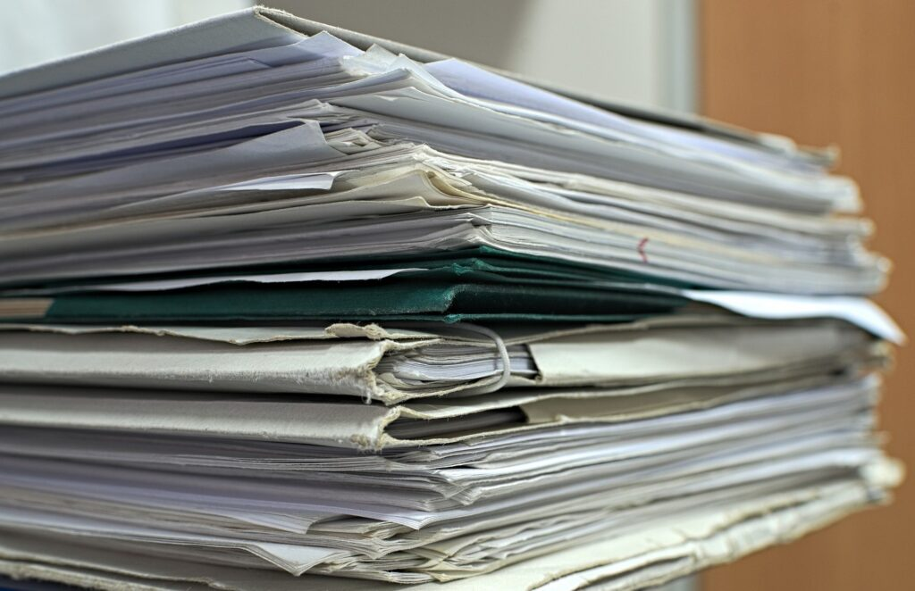 A stack of folders filled with papers.