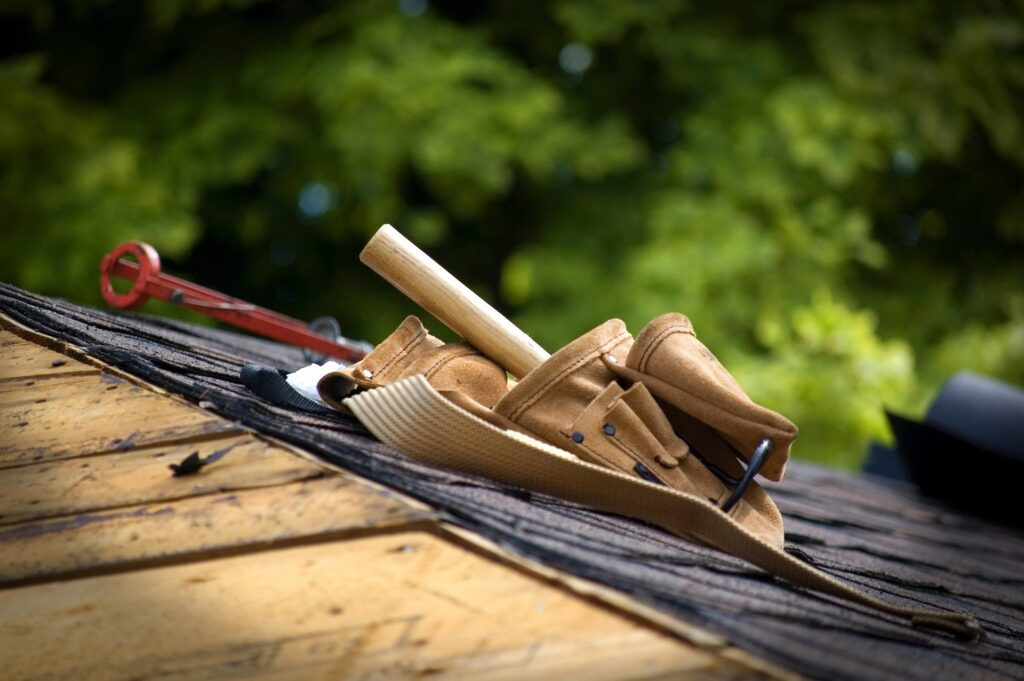 A toolbelt on an unfinished roof.